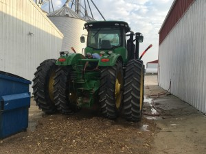 The JD 9360R gets to the wash pad first. This tractor tows the grain cart during harvest. Brandon has started washing it. Soon, it will shine like new!