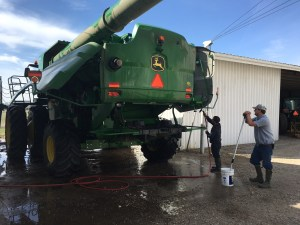The washing of the 680 has begun.  Once the outer skin is scrubbed and rinsed, the combine will be put away for the winter.