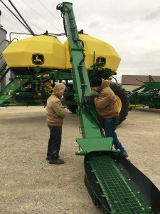 We unfolded the loading conveyor. The flip-over addition at the bottom will be used to slide under a hopper-bottom trailer. If this works like we hope, we will no longer need our old 10-wheeler truck to deliver seed to the planter.