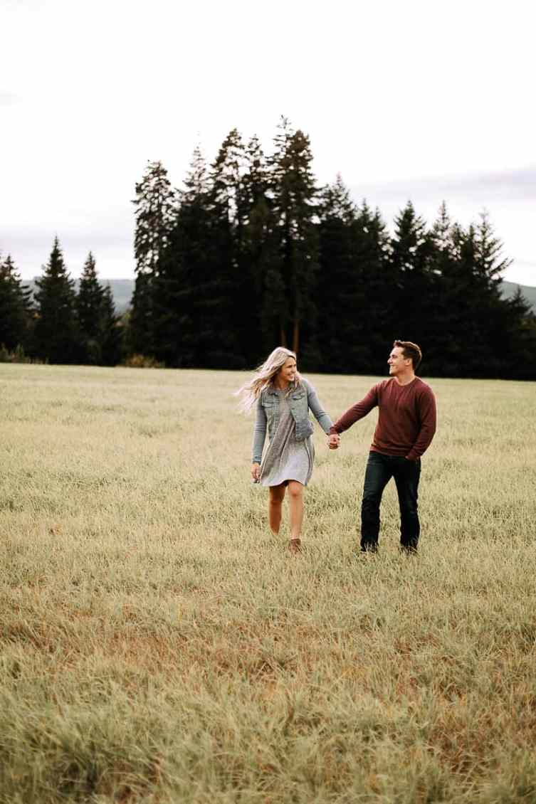 A couple in a field during their hood river oregon engagement