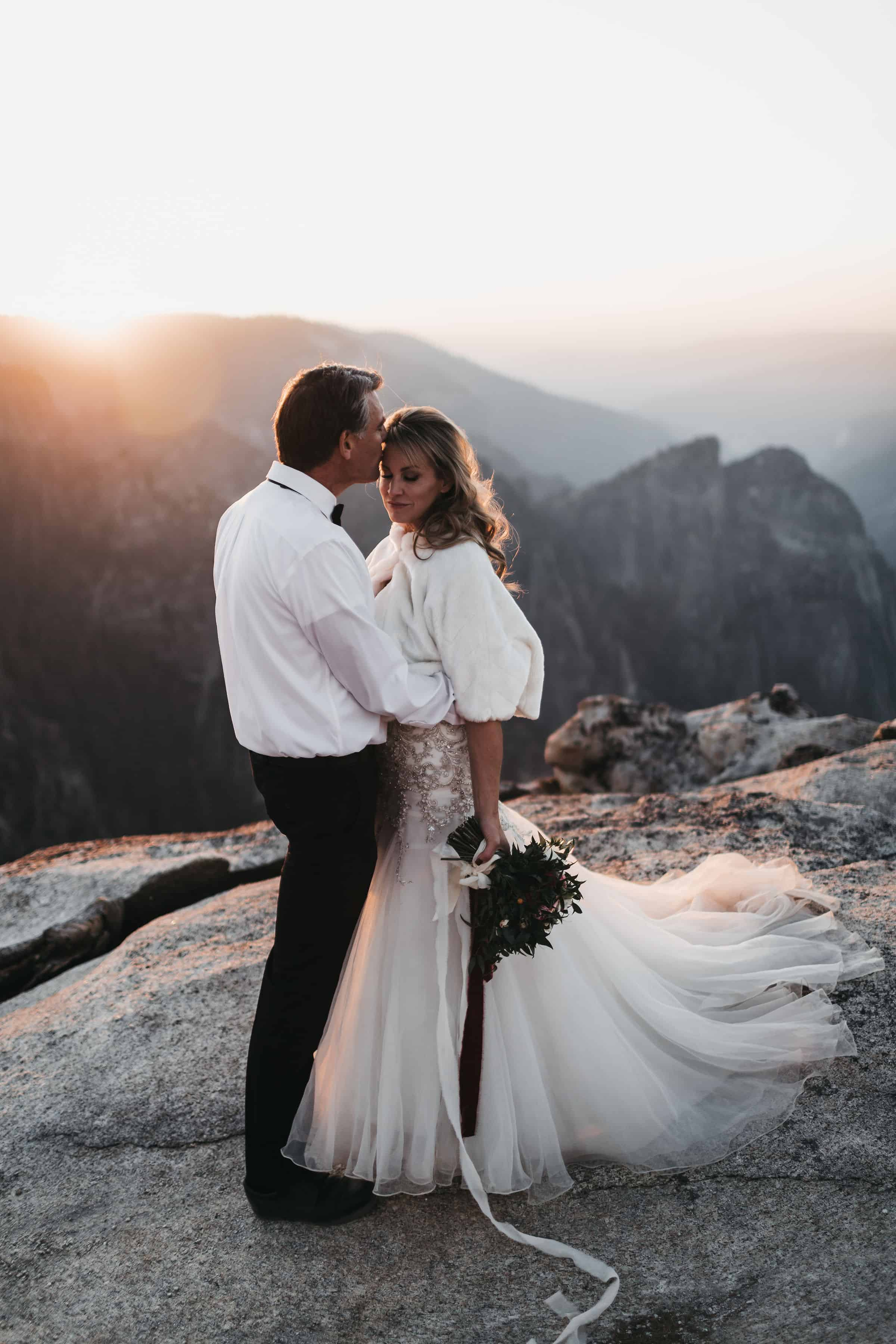 bride and groom at their taft point elopement in yosemite