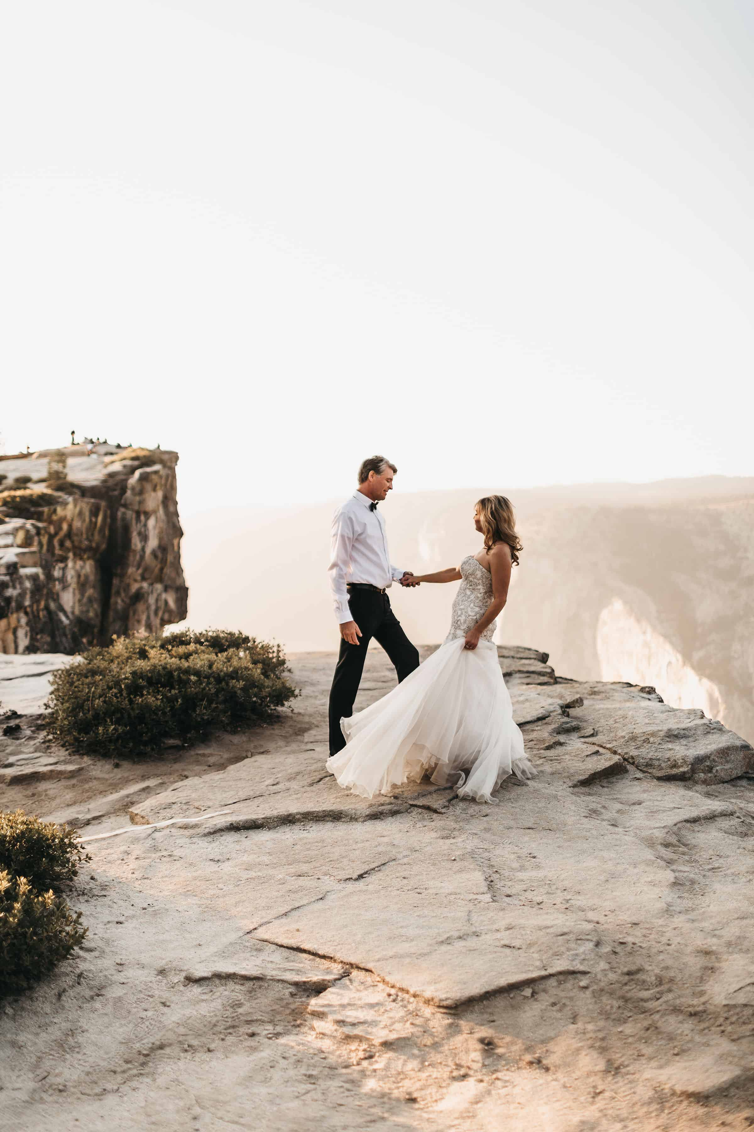bride and groom at their elopement at taft point yosemite