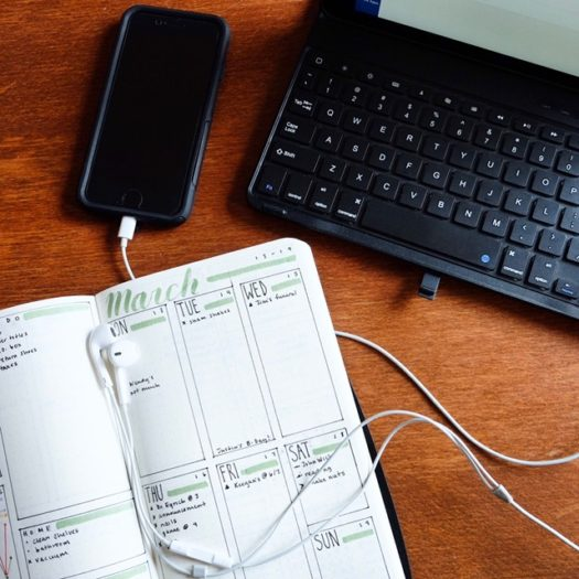 bullet journal and laptop