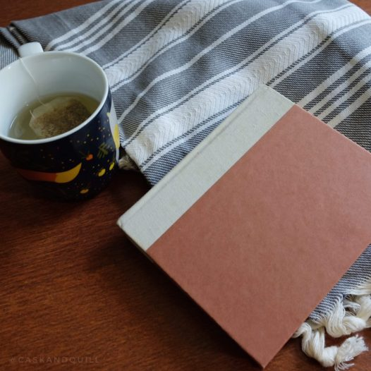 light-weight blanket with tea and book