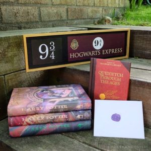 Hogwarts Express sign with Harry Potter books and Hogwarts acceptance letter