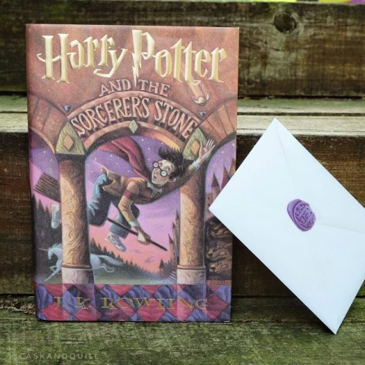 Harry Potter and the Sorcerer's Stone with Hogwarts acceptance letter