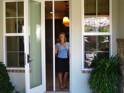 Casper single door retractable screen in white frame on out-swing door