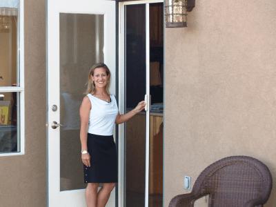 Casper single door retractable screen in white frame on back door.