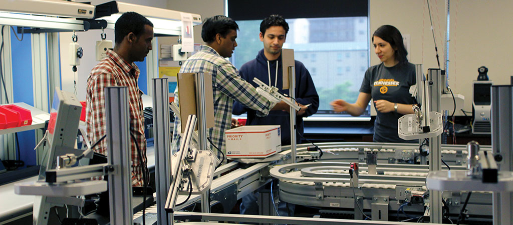 Students working on a project in the Factory Floor lab