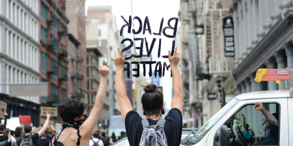 Header image showing protestors taking action against racial injustice