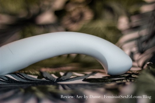 "Image shows Arc by Dame facedown, demonstrating how significant the ""arc"" is. // Feminist Sex Ed Toy Review: Arc by Dame."