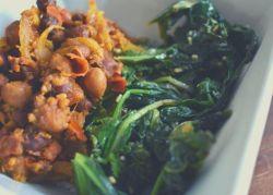 Closeup of chana masala (Indian spiced chickpeas) and sautéed greens