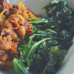 Closeup of chana masala (Indian spiced chickpeas) and sautéed greens