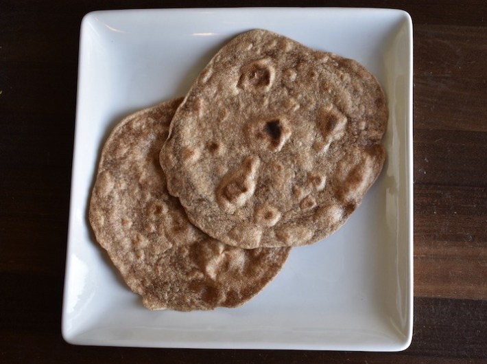 Two roti/chapati a north Indian flatbread on a plate