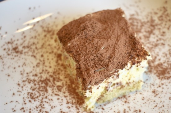 Closeup of Tiramisu Cake with cocoa powder