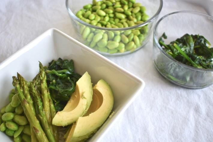 Vegan spring bowl with edamame and sauteed greens