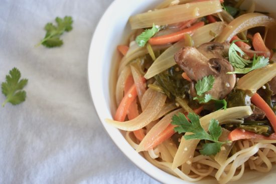 Plant based vegetable Thai noodle soup with brown rice noodles