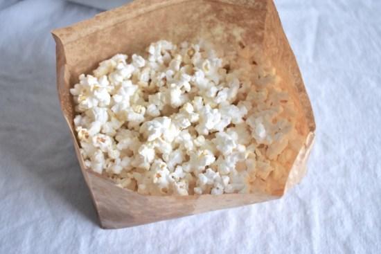 Homemade vegan microwave popcorn with light seasoning