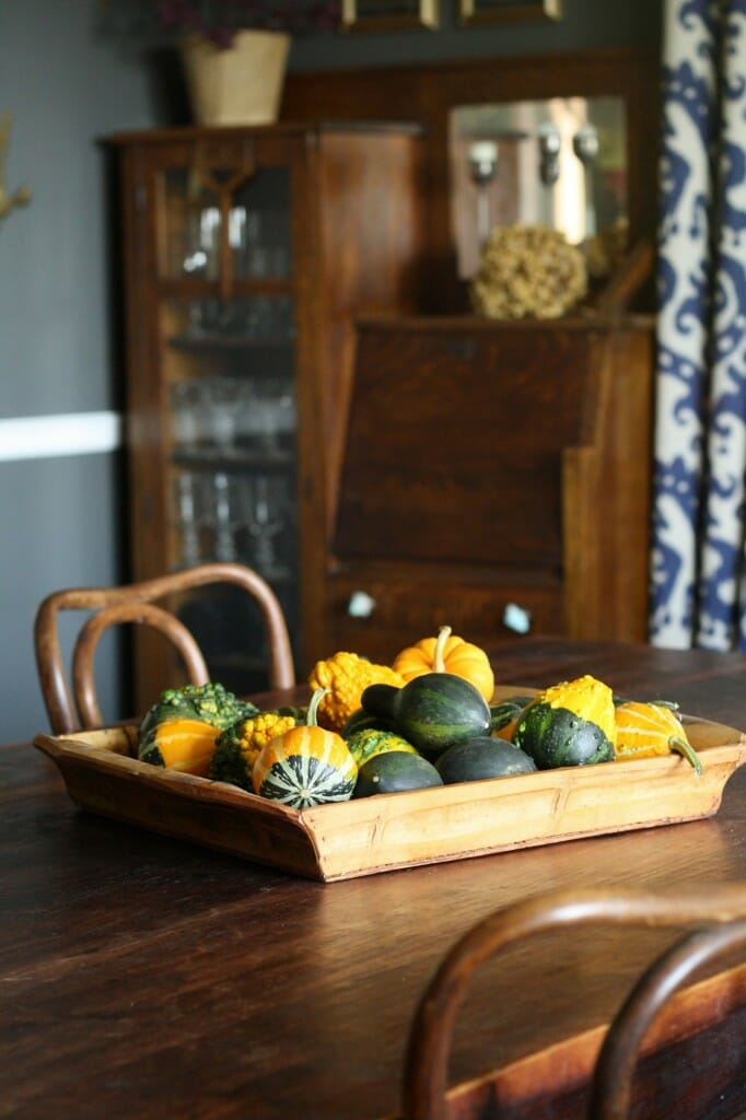 #EclecticallyFall bamboo tray filled with gourds as centerpiece