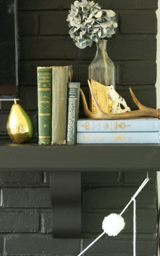 #EclecticallyFall mantle with vintage books, antlers, dried hydrangeas, gold