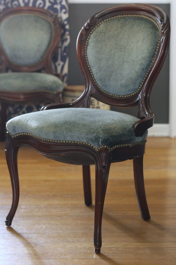 dusty blue velvet chairs in dining room