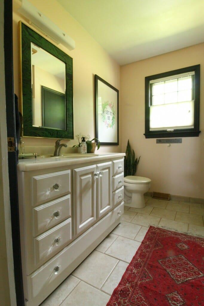 pale pink bathroom with black trim