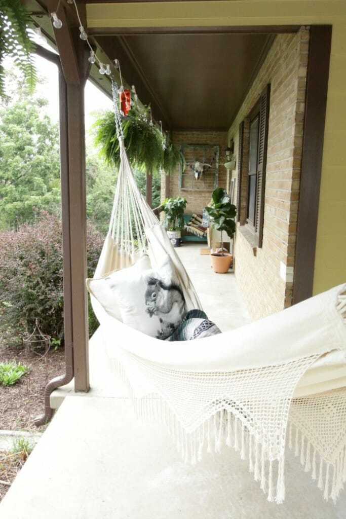 Fringe Hammock with Squirrel pillow on Fall Porch