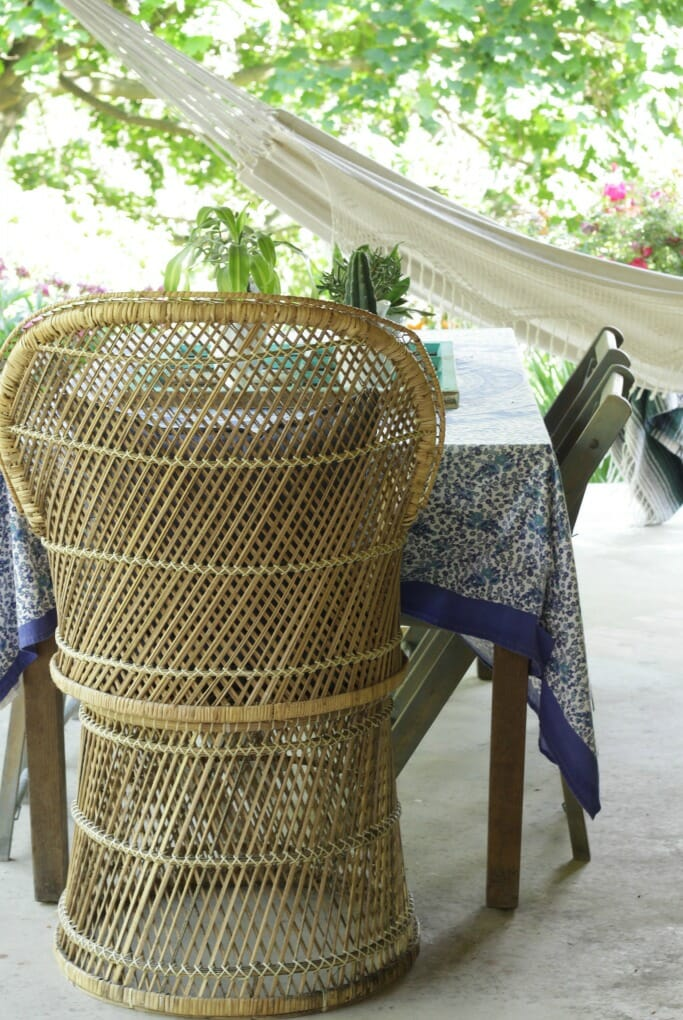 Petite Wicker Fanback chair on boho porch