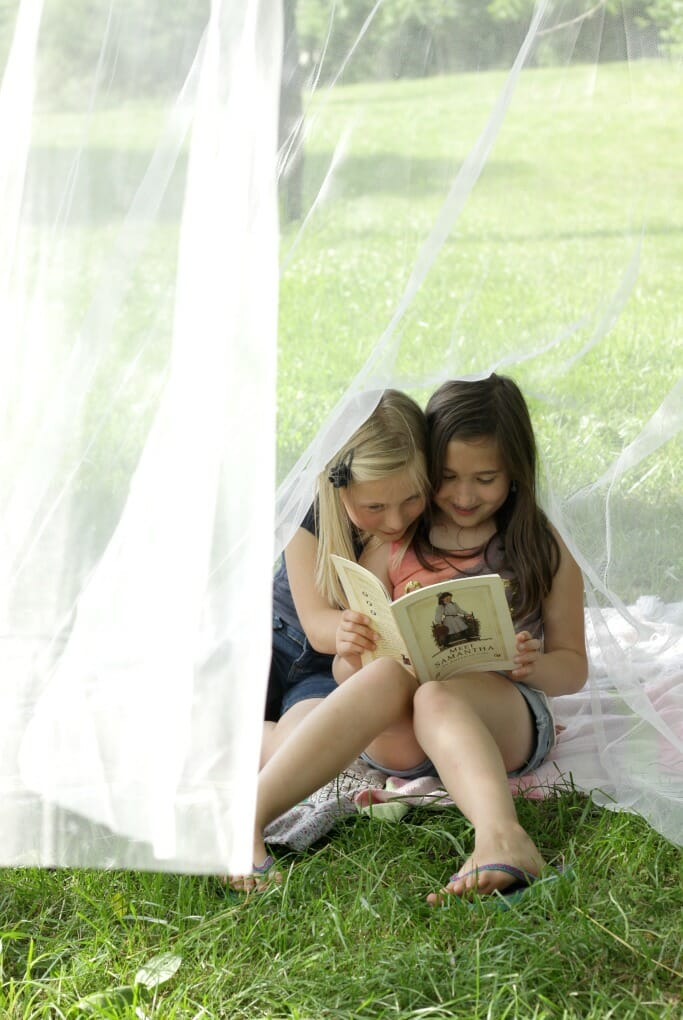 Emmy and friend reading in canopy