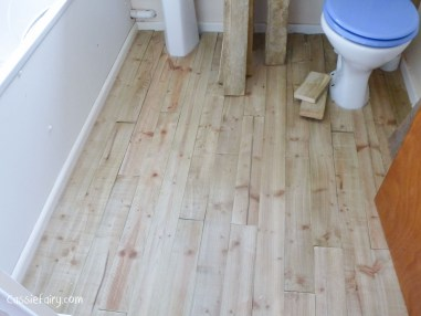 using recycled wood from a skip to make a beach hut bathroom floor and storage-2