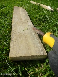 using recycled wood from a skip to make a beach hut bathroom floor and storage-7
