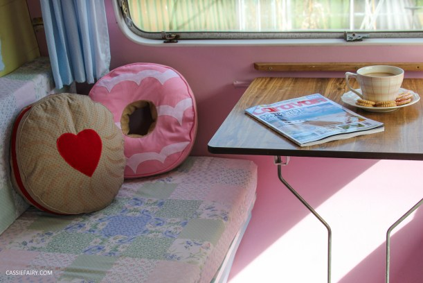 vintage caravan interior with biscuit cushions and cat-13
