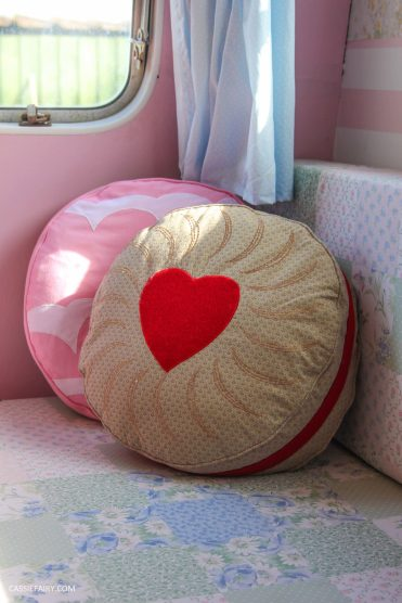 vintage caravan interior with biscuit cushions and cat