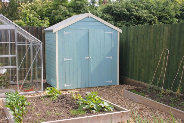 diy painting and installing small shed - duck egg blue beach hut in garden-27