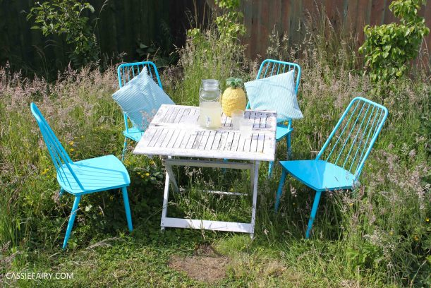 summer party - garden table and chairs in wild flower meadow-11