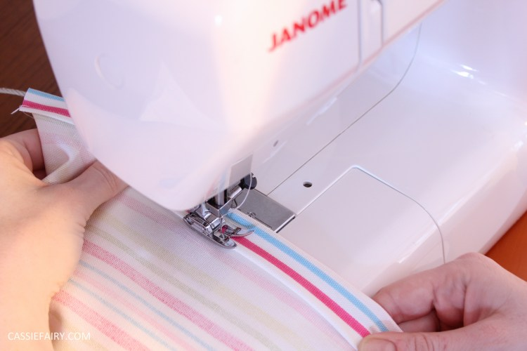 photo of a sewing machine stitching a straight line