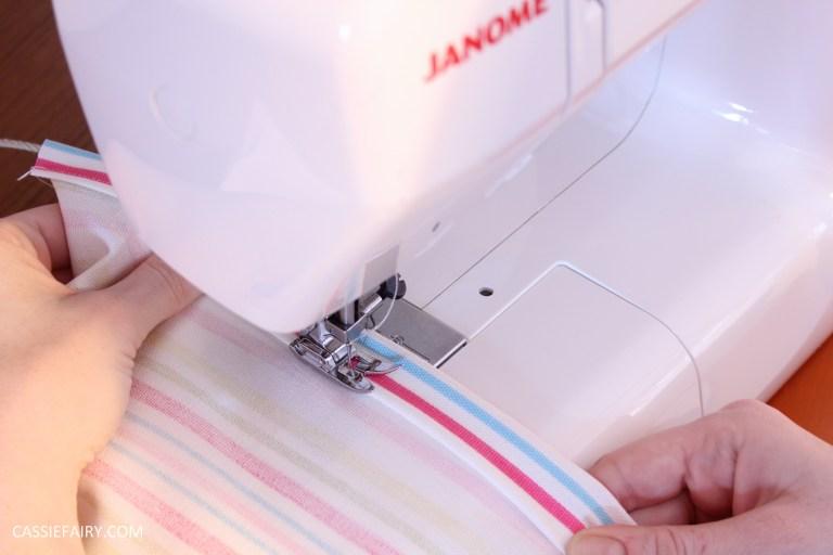 photo of a sewing machine stitching a straight line