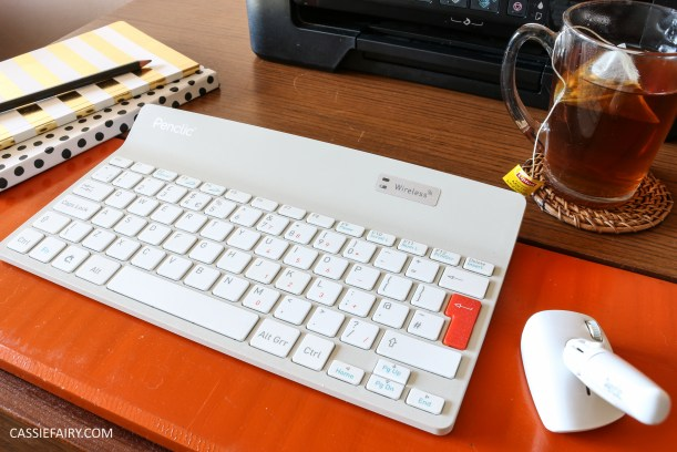 wireless-keyboard-and-mouse-pen-setting-up-an-ergonomic-desk-workspace-7