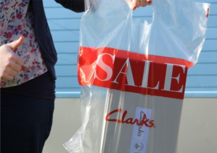 Photo of a shopping bag with the word 'sale' on the front