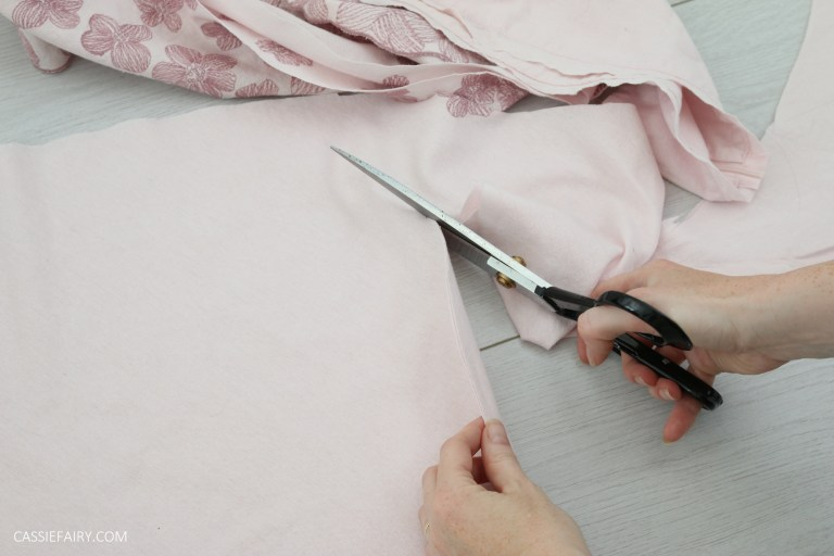 photo of fabric being cut by a pair of fabric shears