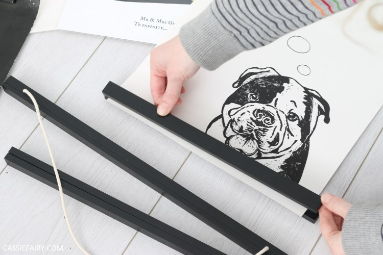 magnetic hanging frame being applied to lino print of a dog