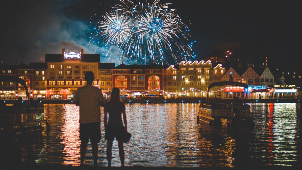 Couple watching fire works from a boat