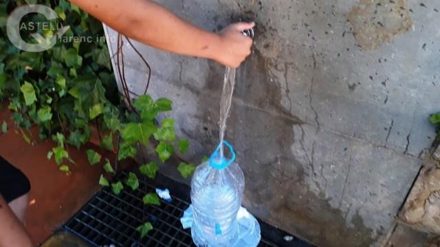 Omplir ampolla aigua