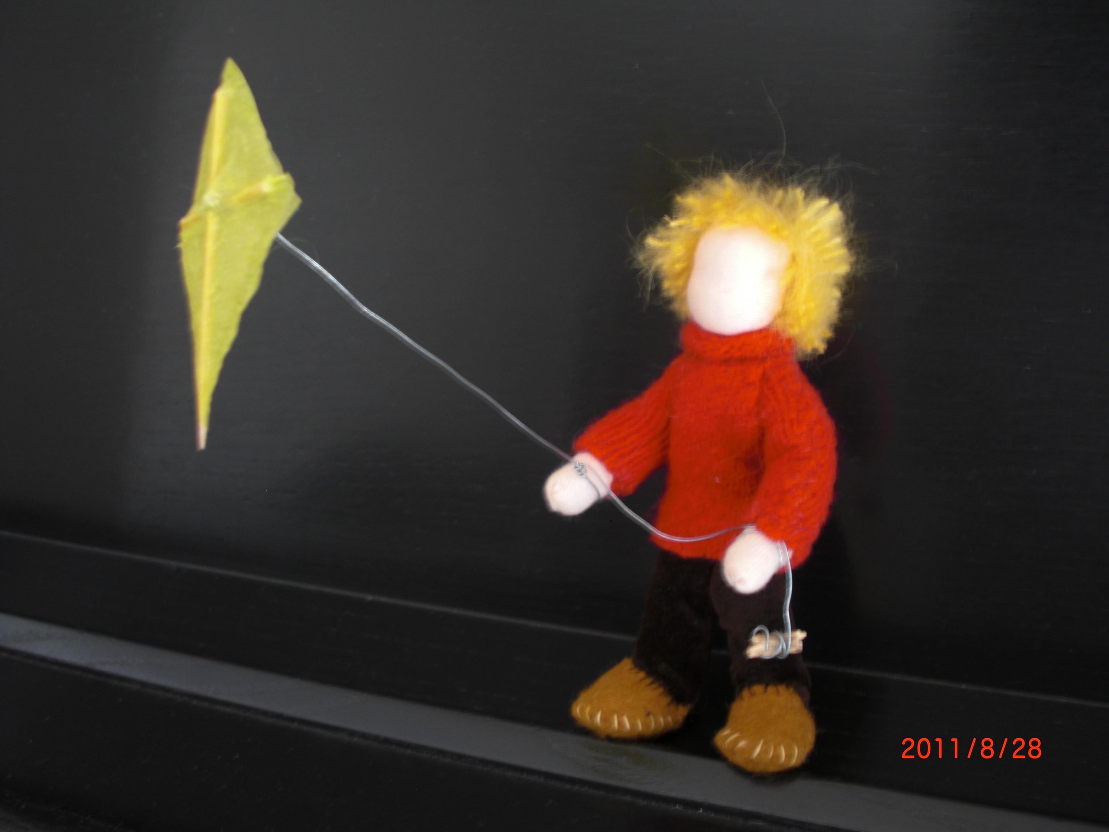 Little Boy Flying A Kite
