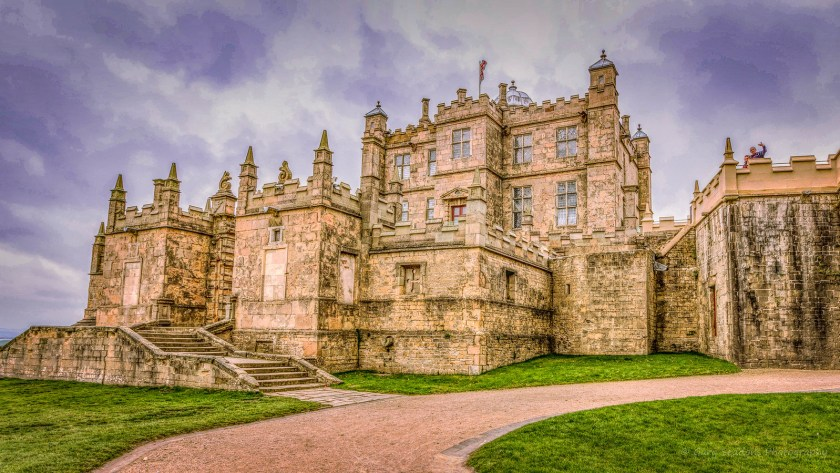 Bolsover Castle - A path leading to stone stairs and a magnificent stone castle with a giant keep behind the walls