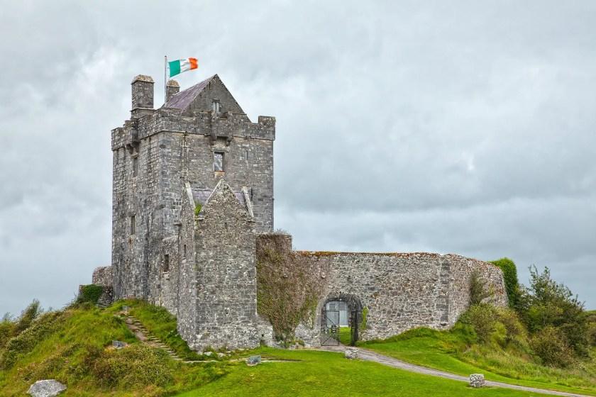Dunguaire Castle with an Irish flag on a mast
