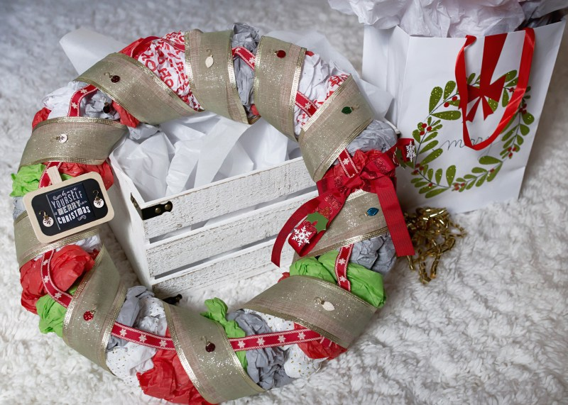 DIY Christmas or holiday wreath made with tissue paper! Perfect for kids to help with!