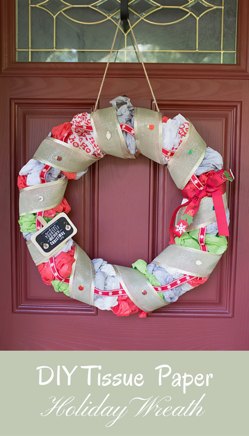 Easy holiday craft perfect for getting kids to help you with - a holiday wreath made of tissue paper!