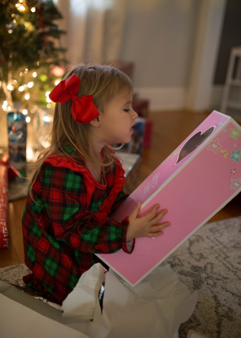 toddler girl christmas opening gifts