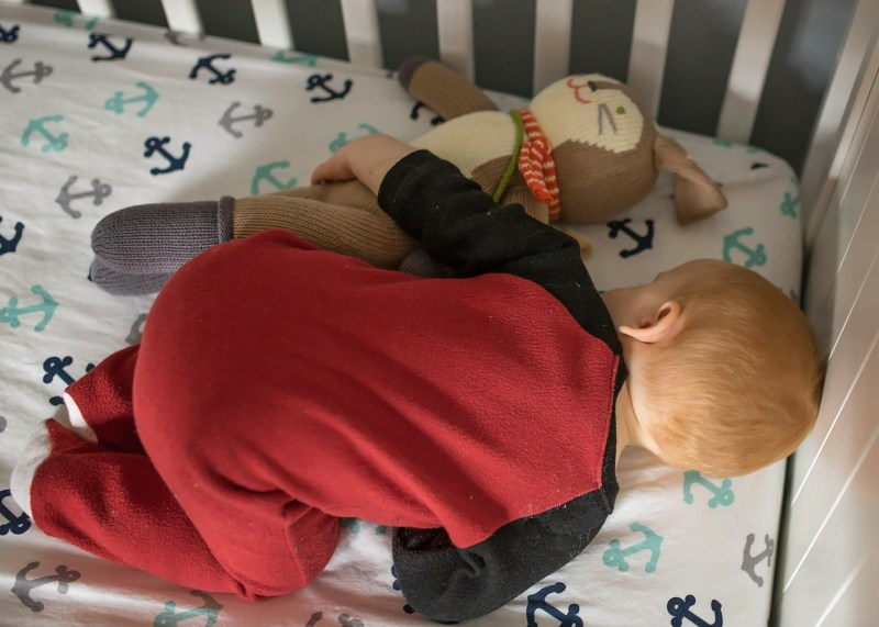 baby boy sleeping with blabla Pierre doll